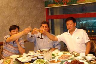 Left Wang Xu President Evergrowing Bank China, George Sfeir Technical Industries, Inc. CEO, Shawsong Director Highland Petroleum